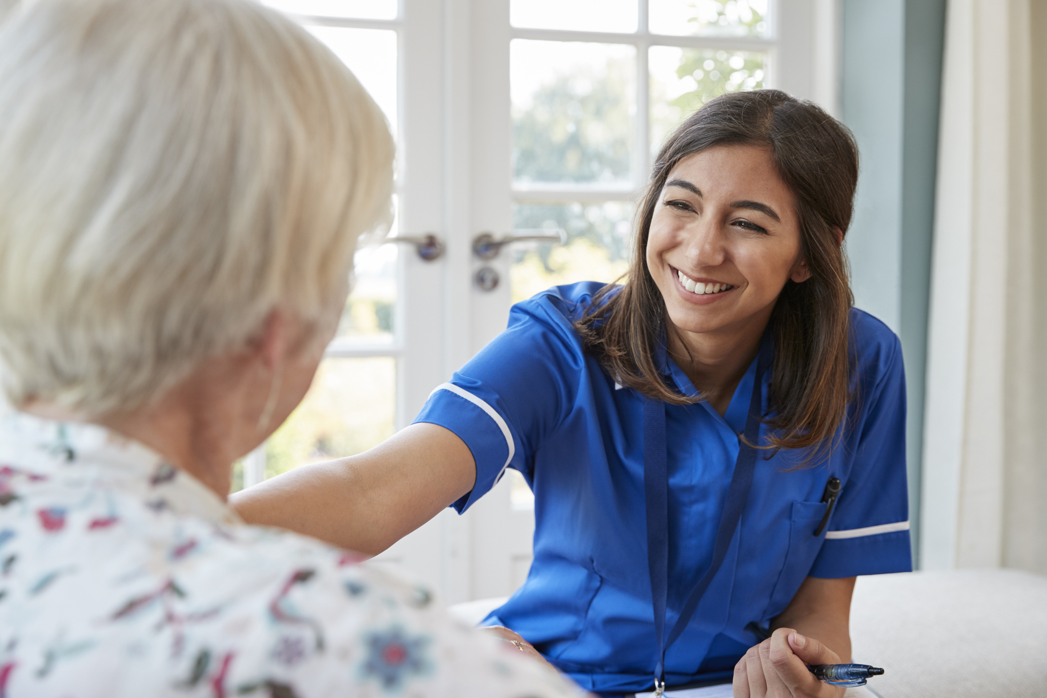 Nursing Assistant Smiling at resident