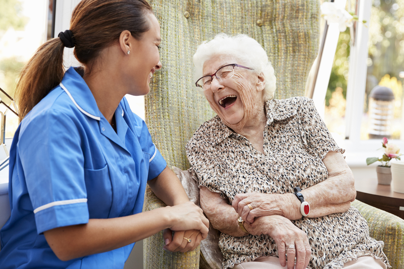 Nursing Assistant & Resident Laughing