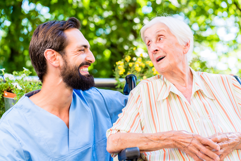 Nursing Assistant Talking With Resident
